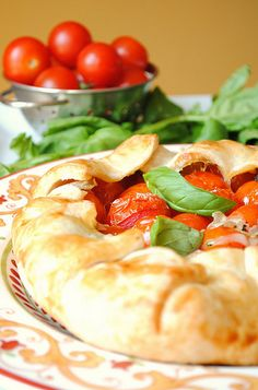 Ingredients:    1 pie shell  15 (approximate) cherry tomatoes  Chunks of fresh mozzarella  Salt and pepper  1 egg  1 tablespoon water  ...