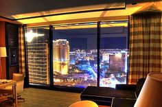 """""""The latest addition to the Wynn Hotel in Las Vegas, Encore is its own tower on the North end of Steve Wynn's property. This view is at night, South down The Strip, from Room 55-10. The original Wynn tower is visible, along with The Venetian, and Treasure Island on the right."""""""