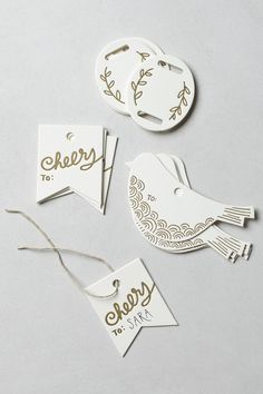 GIFT TAGS :: These could be made w/ cardstock  a gold sharpie along w/ some twine. (Letterpress Gift Tags @ anthropologie.com)