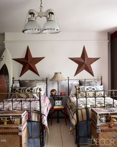 Great pair of matching twin antique iron beds. Perfect for this young boys room.