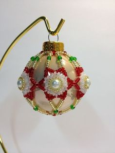 Today I am going to share with you a beaded Christmas bulb I designed. I taught classes for the past two holidays and the students enjo. Wire Ornaments, Handmade Christmas Decorations, Christmas Ornaments To Make, Snowflake Ornaments, Ornament Crafts, Christmas Crafts, Christmas Bulbs, Painted Ornaments, Christmas Snowflakes
