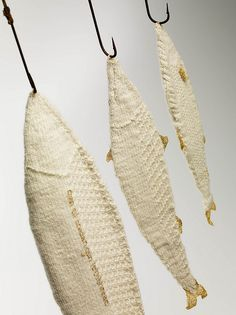 Every nautical home needs knitted fish hanging by the door. fish by d.stitched, via Flickr