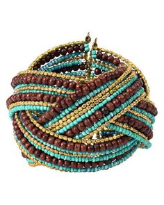Trades of Hope - Become a fashionista with this eye-catching wide beaded cuff bracelet from India. This handcrafted bracelet features gold tone metal with decorated turquoise resin beads and brown wooden beads.    Women in Mumbai are being empowered to be self-reliant. These artisans are able to stay out of sweatshops and avoid the indignity of the sex trade. The old conservative mindset, that has given women a lesser value in India, is being challenged as these women's handcrafts are ...