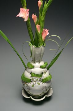 Flower brick   Yixing Stoneware dipped in porcelain slip and decorated with underglaze and sgraffito.   16 x 7 x 7 in.