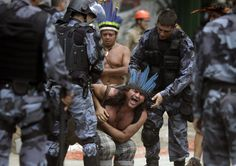 A native Indian reacts as military police officers evict a native Indian community living at the Brazilian Indian Museum in Rio de Janeiro. Description from darkroom.baltimoresun.com. I searched for this on bing.com/images