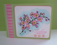 Cherry Blossoms Stamp by Flourishes with Tombow water color markers along with Thinking Of You stamp by Stampin Up.  Parchment paper with piercing design and ribbon.  Shades of Pink & Green