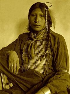 "Simply titled ""Sioux"". If this was a random shot of a group of people where the subjects were unknown, one would understand the absence of names.  But this is a wonderful portrait with no mention of a name. Whoever this young man was or is, we can only pray that his life was lived to its fullest. And if not, that there were times, he found peace and joy even if just for a fleeting moment. Maybe in the arms of his wife, or the joy of watching children grow. We can only wonder."
