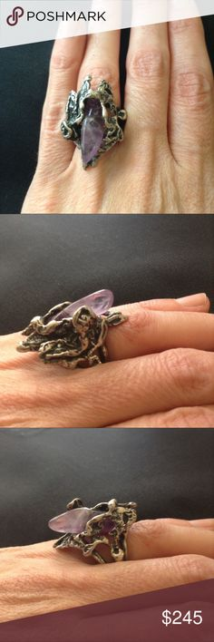 """Vintage Brutalist Amethyst ooak Ring 1970's brutalist, sterling & amethyst hand wrought ring. Incredibly dynamic biomorphic design. The gorgeous, polished, purple stone looks like it is either emerging or landing into a mysterious, free form, seemingly undulating, organic surface. Purchased in Israel. Not stamped but my jeweler confirmed it is silver. 15g. Size7.5. Face is appx 1&1/4"""" long. 1/2"""" high. Comfortable because weight is balanced well. The sculptural, flowing design reminds me of…"""