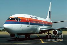 The logo watermark will not appear on purchased products.  A United Airlines 737 begins to depart the terminal at McNary Field in Salem Oregon. I made this photo in August 1978. Photo copyright James B. Toy
