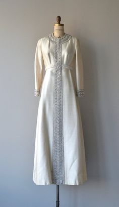 Vintage 1960s ivory Alaskine (silk) wedding gown with regal silver beading, long sleeves, elavated waist, beaded cuffs with metal zippers and long