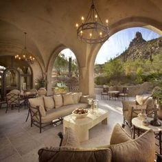 Love it. The soft colors on the groin vaulted ceiling soften the views to the outdoors. I like how the paint color blends with the color of the mountain. The furniture could use a pop of color with some pretty accent pillows and some fresh flowers...