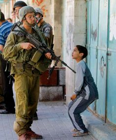 This is what is happening to Palestinians! This is not human.. What has this kid possibly done to this guy with a gun??