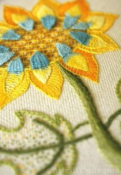 Embroidered flower. The shades of yellow and orange are lovely. #embroidery