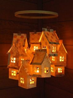 Love this free template and tutorial for creating little houses (that may hold flameless tea lights)