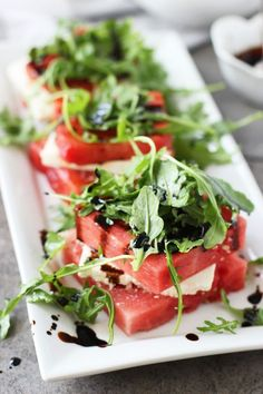 {Grilled watermelon and feta stacked salad.}