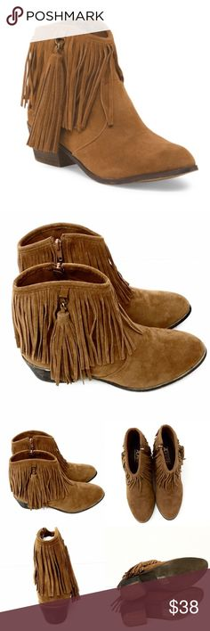 """Adriana New York Western Chic Rust Fringe Bootie You'll look western chic with these cognac fringe booties! They are gorgeous and will add a stylish look to any outfit from shorts to jeans or even a swimsuit! They are cognac colored faux suede with detailed fringe detail, tassel pull side zip and round toe. Approx 2"""" heel. Brand new in box! Adriana New York Shoes Ankle Boots & Booties"""