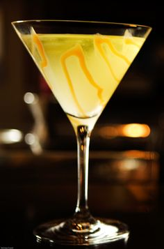 Caramel Appletini  0.5oz Absolut Vodka  0.5oz Butterscotch Schnapps  1oz Apple Pucker  1oz apple juice  Caramel for garnish  Combine all ingredients; shake with ice and strain into a martini glass with caramel swirl inside.