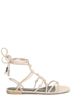 Elyssa Sandal  - Fit to be tied. These sandals feature sexy-cool ropey straps that lace up around your foot and up and around your ankle. And they're flats, so you can wear them all day or keep 'em on hand when your feet need a break from heels.   Style #: M1261018