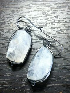 Large moonstones and oxidized silver.  http://www.facebook.com/pages/Yessicas-Designs-Custom-Jewelry/111294745550731