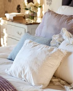 comfy white cotton bedding in light bedroom