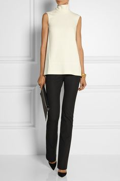 Love the sculptural shape of the top, how it sits just on the hips and straight leg pants. Joseph. #office #work via #thedailystyle