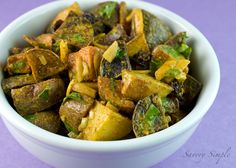 This beautiful and easy curried potato salad is vegan and much lighter than other recipes.