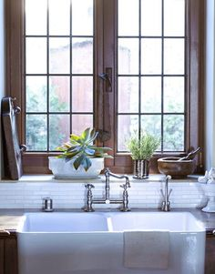 Farmhouse sink, traditional pot filler faucet. & #succulents. #LOVE