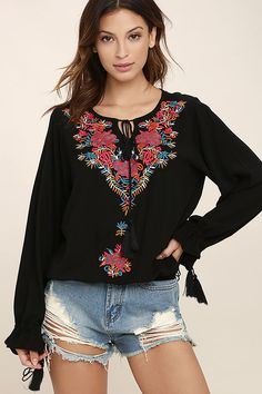 The Merrymaking Black Embroidered Long Sleeve Top has got us in the mood for a getaway! Festive magenta, teal blue, white, and golden yellow embroidery embellishes gauzy woven fabric as it forms this billowing peasant top with a tying neckline and elasticized hem. Long sleeves have drawstring cuffs.
