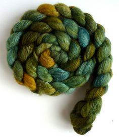 4 ounces of Merino/Superwash Merino/Tussah Silk top, 40/40/20, in Three Waters Farm colorway Olive Green Tonal.    Merino occupies one of the