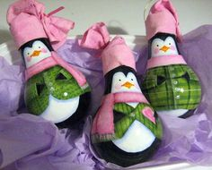 Cute penguin ornaments created from light bulbs! by Robyn Warne Designs #painting #recycled crafts