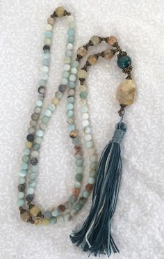 A personal favorite from my Etsy shop https://www.etsy.com/listing/223709477/amazonite-carved-soapstone-and-agate-108