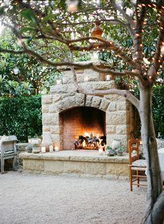 Cozy, romantic outdoor fireplace.   Photo by Brandon David Photographers. www.wedsociety.com  #wedding #furniture