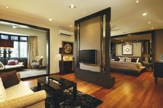 A room divider can be useful also as a support for the TV