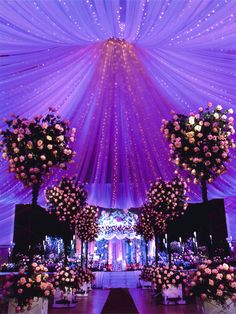Use lighting to coordinate simple decor into the color theme of your wedding. How jaw-dropping is this purple set up?