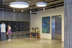 Simple drum LED lights enliven the lobby. David Baker Architects: Onizuka Crossing Family Housing