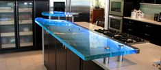 Elevated textured glass countertop with embedded LED lights | Photo Source: Signature Art Glass