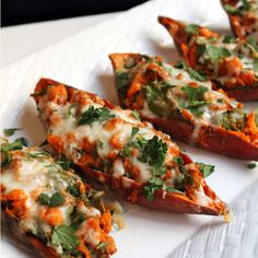 Chipotle Twice Baked Sweet Potatoes Recipe Side Dishes with sweet potatoes, lime, garlic, cumin, chili powder, chipotles in adobo, spinach, chopped cilantro, shredded mozzarella cheese