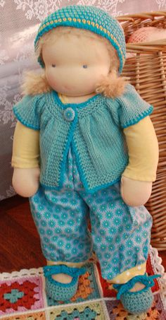 Adorable waldorf doll, love the hat and sweater set