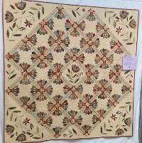 Looking for quilting project inspiration? Check out Dresden bloom appliqué by member Dfullerclark.