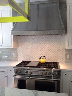 French range hood, gray subway backsplash & marble chevron accent tile