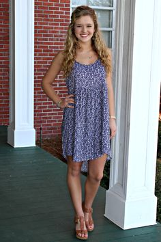 It's time to rise and shine.. Put on your doll face and greet the day with this light frock! It features a fun print and a tie back.