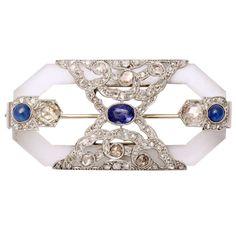 Rock Crystal Sapphire Rose Diamond Platinum  Brooch   From a unique collection of vintage retro bracelets at http://www.1stdibs.com/jewelry/bracelets/retro-bracelets/