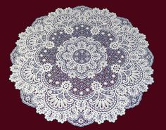 Lace Tablecloth Ajurnaya - an exquisite accessory for your home, which is skillfully emphasizing the delicate taste of the owners. Gossip Bobbin of linen threads of milky color, as can be woven in gray linen. Size 100cm. Production time up to 45 days.