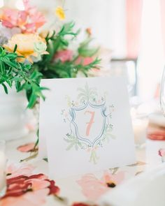 Elegant and Delicate Custom Table Numbers perfect for a spring or summer wedding!   Paper: Mrs Post Stationery Photo: Weddings by Christopher and Nancy Wedding Planner: Bella Baxter Events