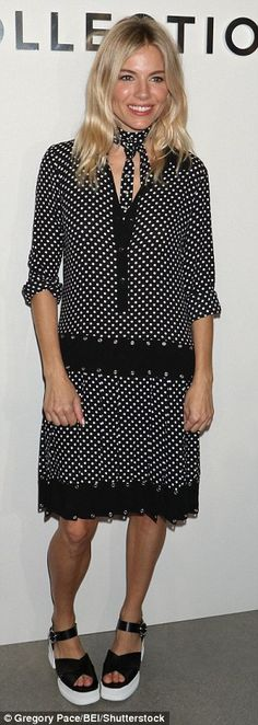 Well spotted!Sienna, 34, opted for a generously cut monochrome dress with a plunging neckline and scalloped hem teamed with a matching neck scarf