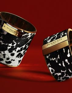 Bold cuffs in glossy animal print calfskin from the Burberry A/W13 accessories collection