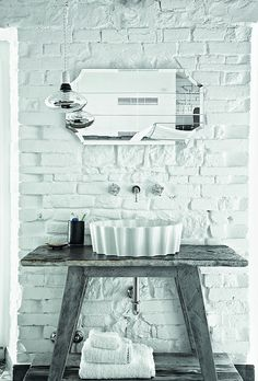 Love, especially, the contrast of the lavatory against the brick with the hits of chrome and mirror.   Paola Navone