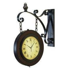 Hanging wall clock with Roman numeral dial and scrollwork accent.Product: Wall clock is Metal and wood w/ Roman numeral dial scrollwork accents; Tabletop Clocks, Wood Clocks, Antique Clocks, 2 Sided Wall Clock, Train Station Clock, Train Stations, Hanging Clock, Industrial Chic, New Wall