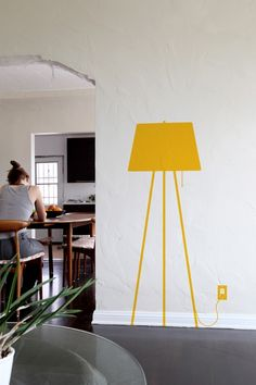 A true leggy supermodel that can brighten up any room. Easy to apply and remove, this tripod lamp wall decal is available in 6 colors. Purchase this vinyl wall sticker lamp from Blik today. Decoracion Low Cost, Guest Room Office, Interior Decorating, Interior Design, Cafe Interior, Vinyl Wall Stickers, Tripod Lamp, Wall Lights, Wall Decor