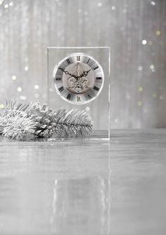 Classic elegance and exposed rotating gears make our Crystal Table Clock an easy addition to any home style.